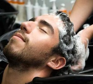 Man having his hair shampooed